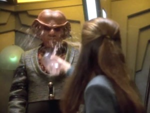 Varis throws a drink in Quark's face.